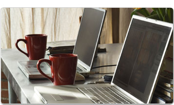 laptops with coffee mugs
